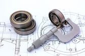 Micrometer measuring ball bearing on technical drawing — Stock Photo