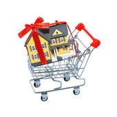 Miniature house in shopping cart isolated on white background — Stock Photo