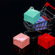 Royalty-Free Stock Photo: Gift boxes in shopping cart isolated on black background