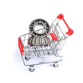 Ball bearings in shopping cart isolated — Stockfoto