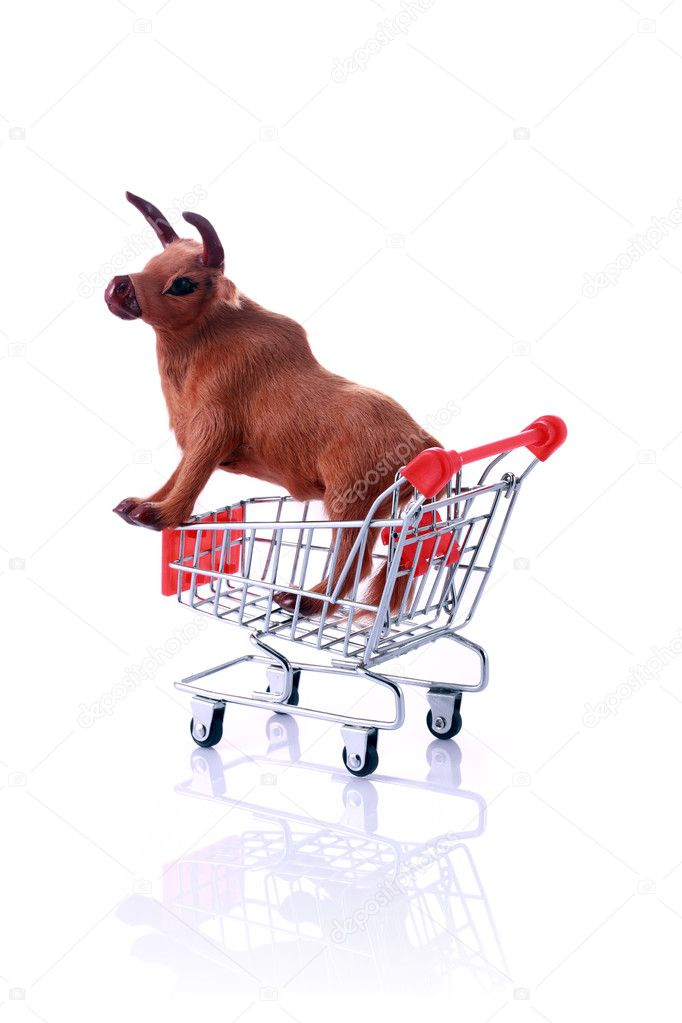 Model cow in shopping cart isolated on white.Shopping for the Feast of SacrificeSeries — Stock Photo #12009748