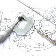 Stock Photo: Micrometer compass and ruler on blueprint
