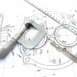 Micrometer compass and ruler on blueprint — Stock Photo