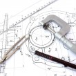 Micrometer, compass, ruler and pencil on blueprint — Stock Photo #12125210