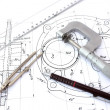 Micrometer, compass, ruler and pencil on blueprint — Stock Photo