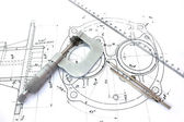 Micrometer compass and ruler on blueprint — 图库照片