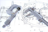Micrometer and caliper on blueprint — Stock Photo