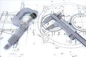 Micrometer and caliper on blueprint — Stock Photo