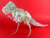 Tyrannosaurus-rex model isolated on red background — Stock Photo