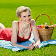 Young blond woman is lying on grass — Stock Photo #10945797
