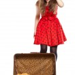 Young teenage girl with an opened suitcase — Stock Photo