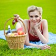 Young blond woman is lying on grass — Stock Photo #11078117