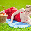 Young blond woman is lying on grass — Stock Photo