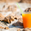 Royalty-Free Stock Photo: A glass of juice on the beach