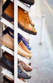 Men shoes is on the shelf — Stock Photo