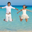 The couple is jumping in the sea — Stock Photo #11897197