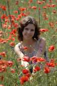 Girl in the poppy field — Stock Photo