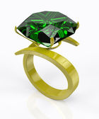 Gold ring with an emerald — Stock Photo