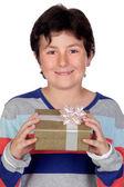 Adorable boy with a present — Stock Photo