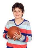 Adorable boy with a big piggy-bank — Stok fotoğraf