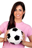 Atractive girl with a soccer ball — Stok fotoğraf