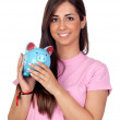 Atractive girl with a blue piggy-bank — Stock Photo