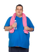 Fat man playing sport with a water bottle — Stock Photo