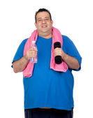 Fat man in the gym with a water bottle — Stock Photo