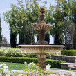 Stock Photo: Flowerbeds and fountain in one of park