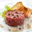 Beef tartar with capers - Stock Photo