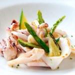 Grilled calamari with green asparagus. — Stock Photo #10886075