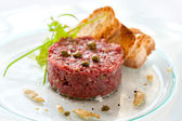 Beef tartar with capers — Stock Photo