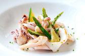 Grilled calamari with green asparagus. — Stock Photo