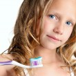 Close up of cute girl holding toothbrush. — Stock Photo
