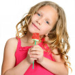 Close up of cute girl holding candy rose. — Stock Photo