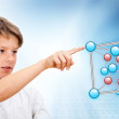 Young boy pointing at 3D molecules. — Stock Photo