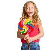 Retrato da menina bonito com doces. — Fotografia Stock