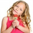 Close up of cute girl holding candy rose. — Stock Photo #11302032