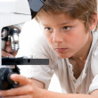Close up portrait of boy with microscope. - Stockfoto