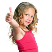 Cute girl holding thumbs up — Stock Photo