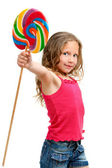 Cute girl holding candy stic. — Stock Photo
