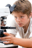 Close up portrait of boy with microscope. — Stock Photo