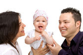 Young couple with their baby daughter. — Stock Photo