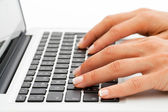 Extreme close up of hands on keyboard. — Stock Photo