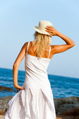 Young woman in white dress on beach. — Stock Photo