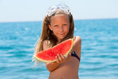 Close up portrait of girl eating watermelon. — Stock Photo
