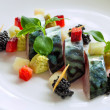 Close up of grilled mackerel fish with blackberries. - Stock Photo