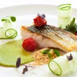 Grilled seabass with cherry tomatoes and avocado. - Stock Photo