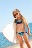Cute gril ready to go surfing. — Stock Photo