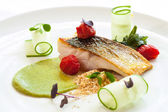 Grilled seabass with cherry tomatoes and avocado. — 图库照片